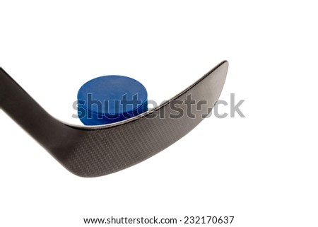 Closeup hockey stick hits the puck blue isolated on white background - stock photo