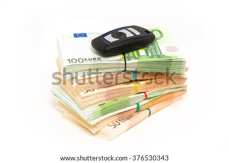 Closeup image car key on pile stack of euro banknotes isolated white background. Dealership offering credit line finance services. Lease automobile purchase financing concept idea. Financial success  - stock photo
