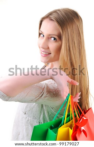 Closeup image of a teen girl holding shopping bags - stock photo