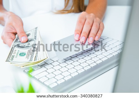 closeup image of a woman hands holding money and credit card - stock photo