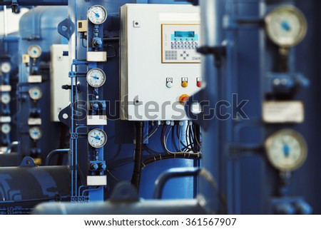 Closeup image of barometers at a brewery industrial plant. - stock photo