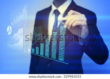 Closeup image of businessman drawing  graph,business strategy as concept - stock photo