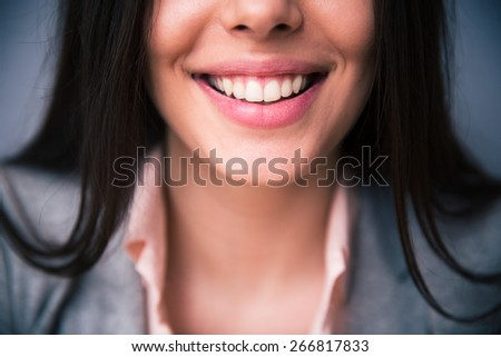 Closeup image of female smile - stock photo