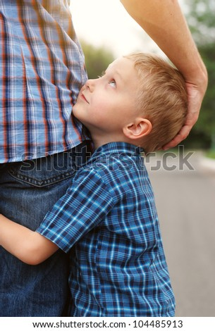 Closeup image of little son tender hugging his father - stock photo