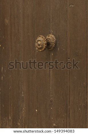 Closeup image of old door with iron handle  - stock photo