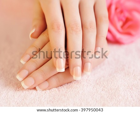 Closeup image of pink french manicure - stock photo