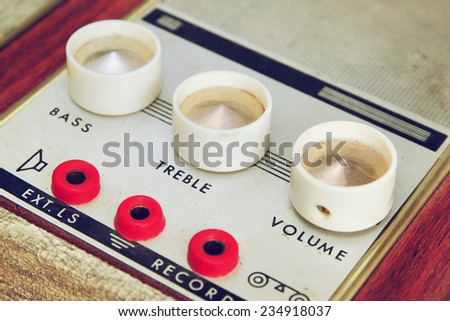 closeup image of vintage record player amplifier dials. selective Focus - stock photo