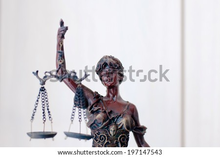 closeup image on sculpture of themis, femida or justice goddess holding scale on white copy space background - stock photo