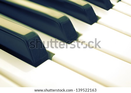 closeup image piano keys in old style - stock photo
