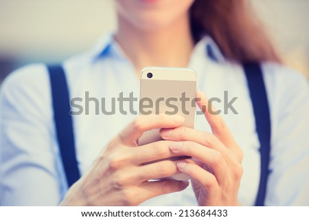 Closeup image woman hands holding, using smart, mobile phone isolated outside city background. New generation technologies, people phone addiction concept. Customer, service provider relationship - stock photo