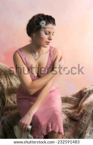 Closeup in vintage colors of a 1920s style young woman with diamond headdress and flapper dress - stock photo