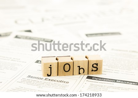 closeup jobs wording on classifieds ads and newspaper, recruitment and employment concepts and ideas - stock photo