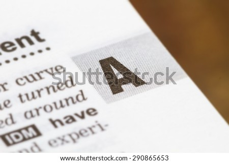closeup letter A in dictionary, soft focus, - stock photo