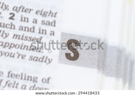 closeup letter S in dictionary, soft focus, - stock photo