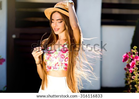 Closeup lifestyle woman portrait,sexy sensual seductive woman with long natural hair walking alone at windy day,perfect hairstyle,amazing smile and big blue eyes.Fashion glasses,autumn look,warm toned - stock photo