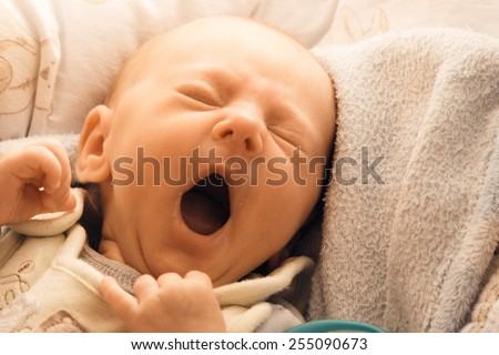 Closeup little newborn baby girl three weeks lying in diaper with open mouth - stock photo