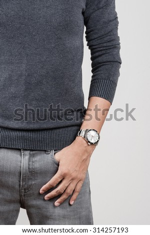 closeup luxury watch on wrist of man - stock photo