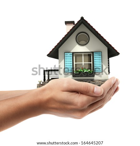Closeup. Man's hand holding house  isolated on white background. High resolution - stock photo