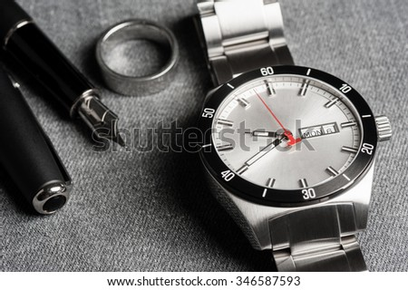 closeup men watch with stainless steel bracelet - stock photo