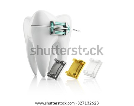closeup metal bracket on tooth, with samples of metallic gold and ceramic braces, isolated on white background - stock photo