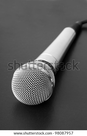 Closeup microphone on black background - stock photo