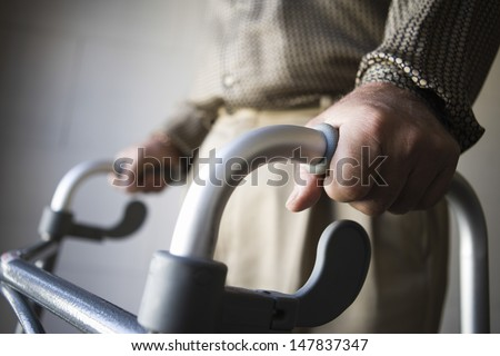 Closeup midsection of a man using walking frame - stock photo