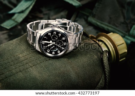 Closeup military or field style wristwatch, luxury automatic wristwatch for men - stock photo