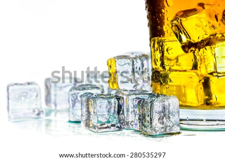 Closeup misted on glass of whiskey and ice on white - stock photo