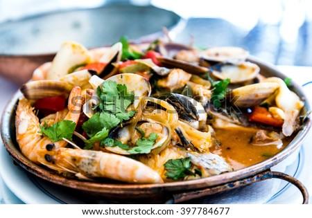 closeup mix seafood soup pot. - stock photo