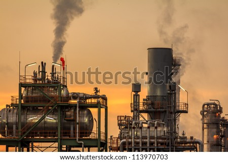 Closeup Morning Sunlight At Petroleum Refinery - stock photo