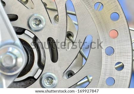 Closeup Motorbike engine disk brake - stock photo
