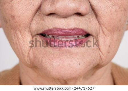 closeup mouth of elderly woman - stock photo