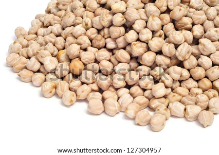 closeup of a a pile of dried chickpeas on a white background - stock photo