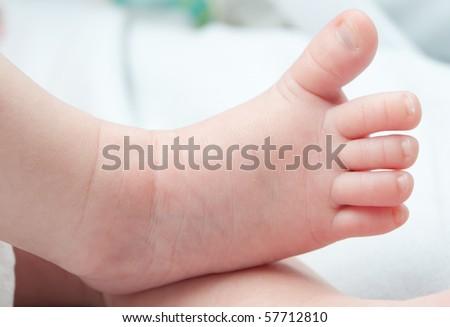 closeup of a baby`s feet - stock photo