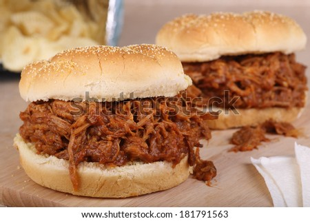 Closeup of a barbecue pulled pork sandwich - stock photo