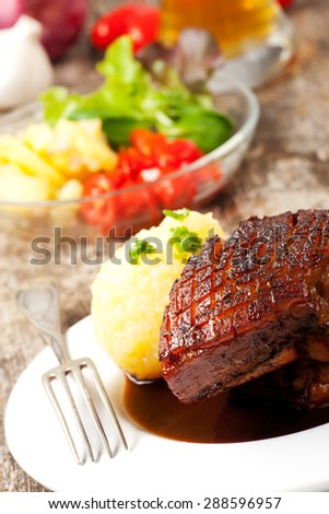 closeup of a bavarian roast pork dish  - stock photo