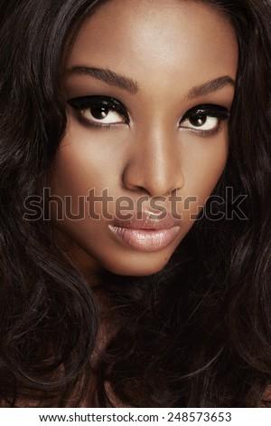 Closeup of a beautiful African woman with makeup. - stock photo
