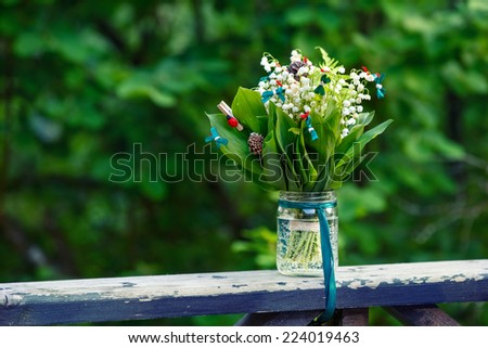 Closeup Of A Beautiful Bouquet On Wooden Railing outdoors - stock photo
