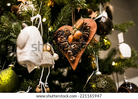 Closeup of a beautiful hand-made christmas tree decorations made for New Year celebration - stock photo