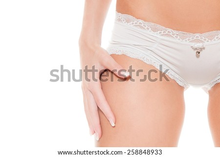 Closeup of a beautiful naked woman in white panties, photo with copy space on the left side of the image, isolated on white studio background - stock photo