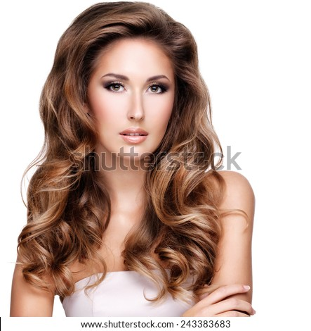 Closeup of a beautiful woman with long brown wavy hair, isolated on white - stock photo