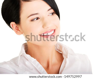 Closeup of a beautiful young businesswoman looking to the side. Isolated on white background - stock photo