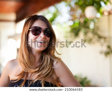 Closeup of a blond caucasian woman with sunglasses outdoor - stock photo