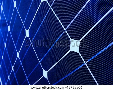 Closeup of a blue photovoltaic solar cell - stock photo