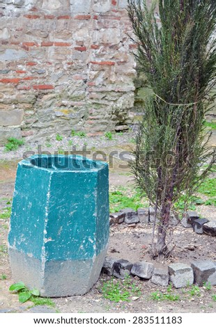 Closeup of a blue trash can on the street in pastel colors - stock photo