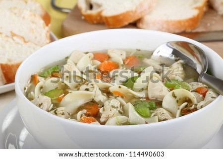 Closeup of a bowl of chicken and noodle soup - stock photo