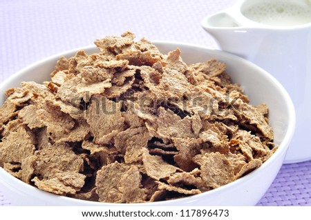 closeup of a bowl with muesli at breakfast time - stock photo