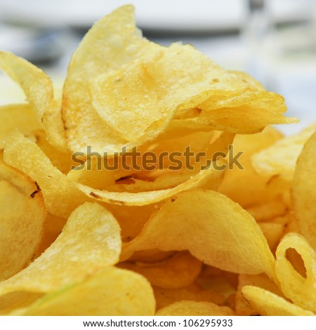 closeup of a bowl with potato chips - stock photo