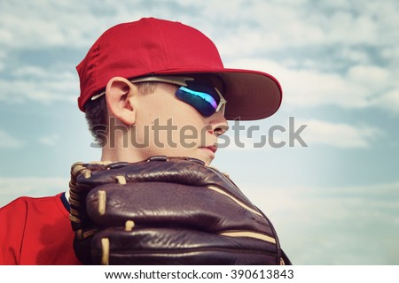 Closeup of a boy pitcher, focus on side of boys face. Instagram toned image. - stock photo