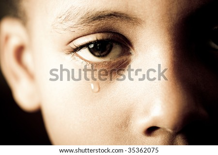 closeup of a boy's face - crying tears - stock photo